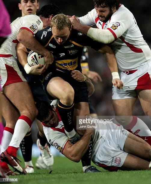 Scott Donald of Leeds Rhinos is tackled during the engage Super League Grand Final between St Helens and Leeds Rhinos at Old Trafford on October 13...