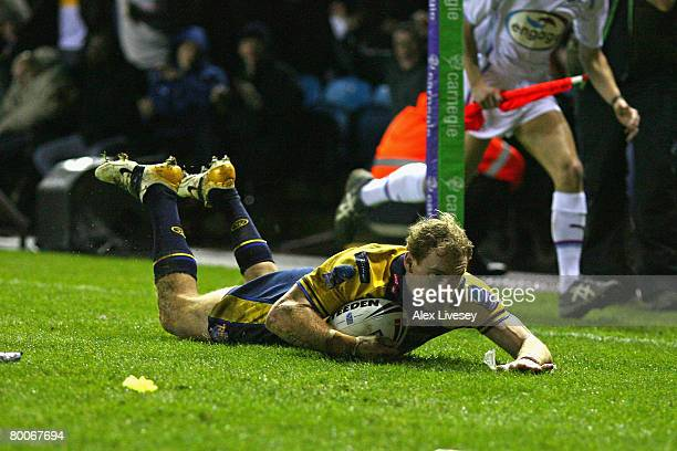 Scott Donald of Leeds Rhinos scores his team's first try during the Carnegie World Club Challenge match between Leeds Rhinos and Melbourne Storm at...