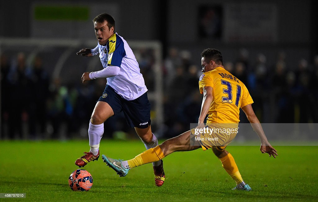Scott Donnelly of Havant gets round Alan Browne of Preston during the FA Cup First Round match between Havant & Waterlooville FC and Preston North End on November 10, 2014 in Havant, England.
