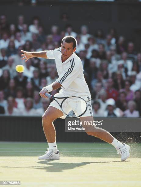 Scott Draper of Australia makes a forehand return against Tim Henman of Great Britain during their Men's Singles second round match of the Wimbledon...