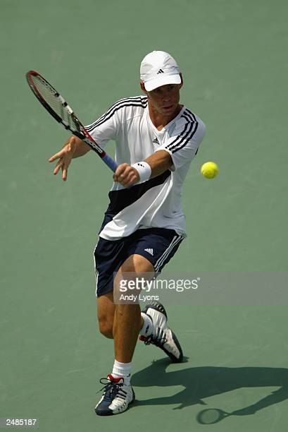 Scott Draper of Australia returns a shot during his 466376 loss to Roger Federer of Switzerland during the Western and Southern Financial Group...