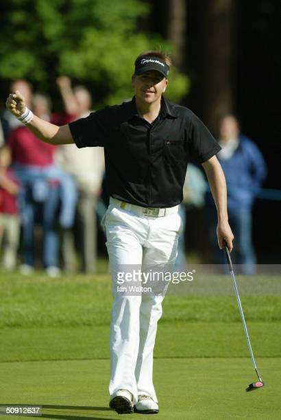 Scott Drummond of Scotland acknowledges the crowd after birding the 14th hole during the final round of the Volvo PGA Championship at the Wentworth...