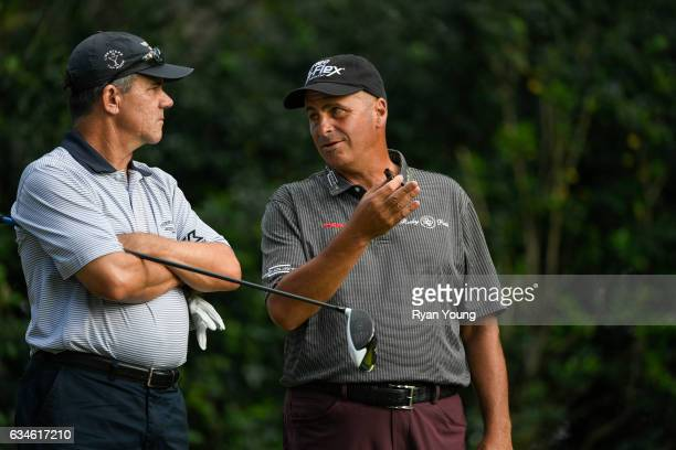 Scott Dunlap and Rocco Mediate talk while waiting to tee off on the 18th hole during the first round of the PGA TOUR Champions Allianz Championship...