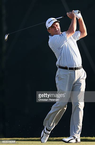 Scott Dunlap hits a tee shot on the 11th hole during the second round of the 2014 US Senior Open Championship at Oak Tree National on July 11 2014 in...