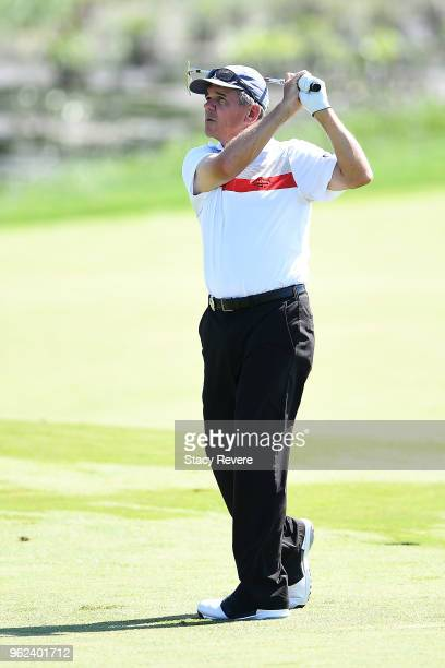 Scott Dunlap hits his second shot on the 18th hole during the second round of the Senior PGA Championship presented by KitchenAid at the Golf Club at...