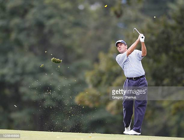 Scott Dunlap hits his second shot to the ninth green during the third round of the Mylan Classic presented by CONSOL Energy at Southpointe Golf Club...
