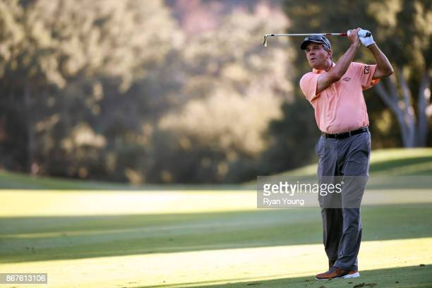 Scott Dunlap plays a shot on the 18th hole during the second round of the PGA TOUR Champions PowerShares QQQ Championship at Sherwood Country Club on...