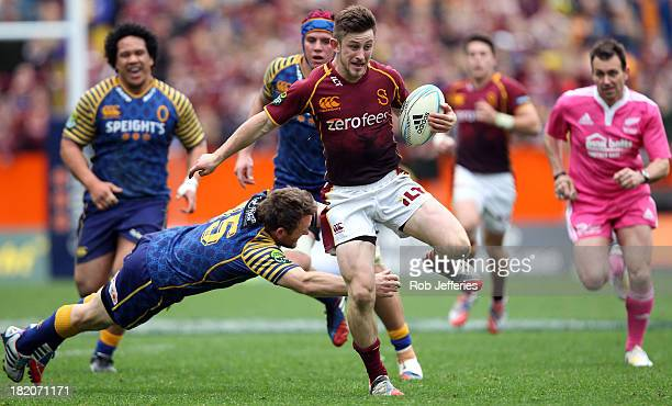 Scott Eade of Southland busts the tackle of Otago fullback Peter Breen during the round seven ITM Cup match between Otago and Southland at Forsyth...