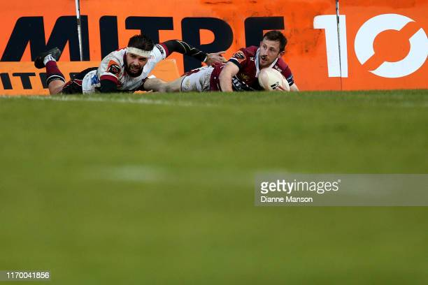 Scott Eade of the Southland Stags scores a try while in the tackle of Matt McGahan of North Harbour during the round 3 Mitre 10 Cup match between...