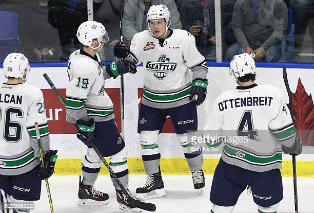 Scott Eansor of the Seattle Thunderbirds celebrates his goal against the Vancouver Giants with teammate Donovan Neuls during the third period of...