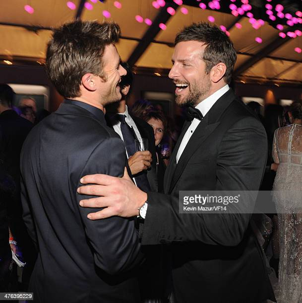 Scott Eastwood and Bradley Cooper attend the 2014 Vanity Fair Oscar Party Hosted By Graydon Carter on March 2 2014 in West Hollywood California