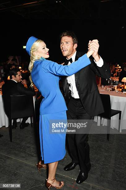 Scott Eastwood dances with a guest during the IWC 'Come Fly with us' Gala Dinner during the launch of the Pilot's Watches Novelties from the Swiss...