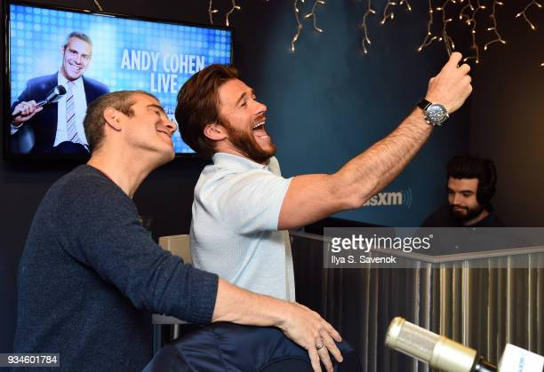 Scott Eastwood poses for a photo with SiriusXM host Andy Cohen during a visit to SiriusXM's 'Radio Andy' at the SiriusXM Studios on March 19 2018 in...