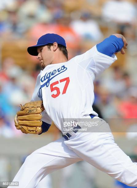 Scott Elbert of the Los Angeles Dodgers pitches during a Spring Training game against the San Francisco Giants at Camelback Ranch on March 4 2009 in...