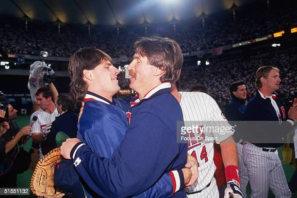 Scott Erickson and Jack Morris of the Minnesota Twins embrace during the Twins' celebration during the World Series against the Atlanta Braves at the...