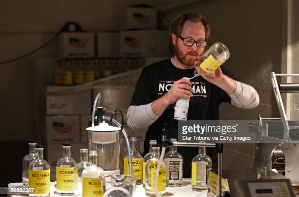 Scott Ervin cleaned bottles before filling with Norseman Vodka on 1/10/14. The year starts off with a high-proof bang, as micro-distillers open in...