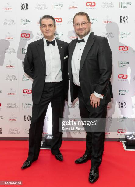 Scott Ewing and Tony Kent attend the Float Like A Butterfly Ball in aid of Caudwell Children at The Grosvenor House Hotel on November 16, 2019 in...