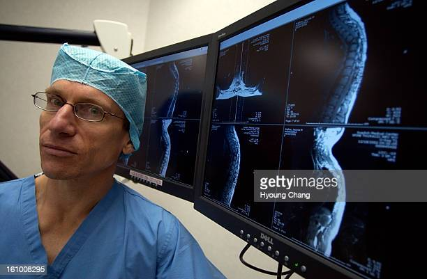 DENVER COLO NOVEMBER 18 2004 Scott Falci neurosurgeon at Craig Hospital in Englewood Colo is in the operation room on Thursday morning He's involved...
