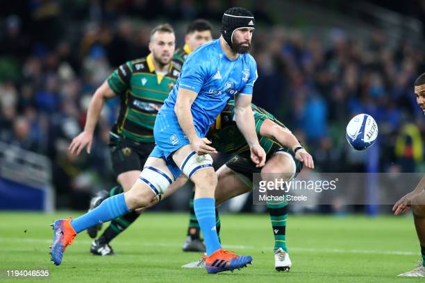 Scott Fardy of Leinster feeds a pass during the Heineken Champions Cup Round 4 match between Leinster Rugby and Northampton Saints at Aviva Stadium...