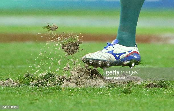 Scott Fardy of the Wallabies kicks the playing surface after it was ripped up in a scrum in the first half and the players had to move to rehold the...