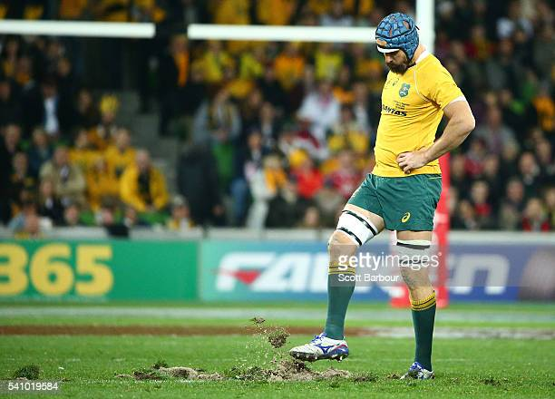 Scott Fardy of the Wallabies kicks the turf after it was ripped up in a scrum in the first half and the players had to move to rehold the scrum...