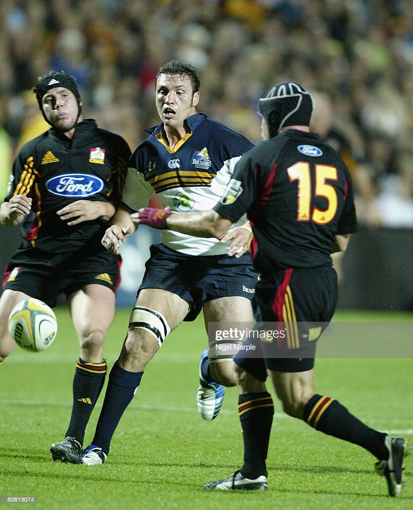 Scott Fava #8 of the Brumbies chases the loose ball with Issac Boss #9 (L) and Todd Miller #15 (R) during the Super 12 game between the Chiefs and Brumbies at Waikato Stadium in Hamilton, New Zealand on May 8, 2004. The Chiefs scored a point by finishing within 8 points of the Brumbies to go through. The Brumbies won the match 15-12.