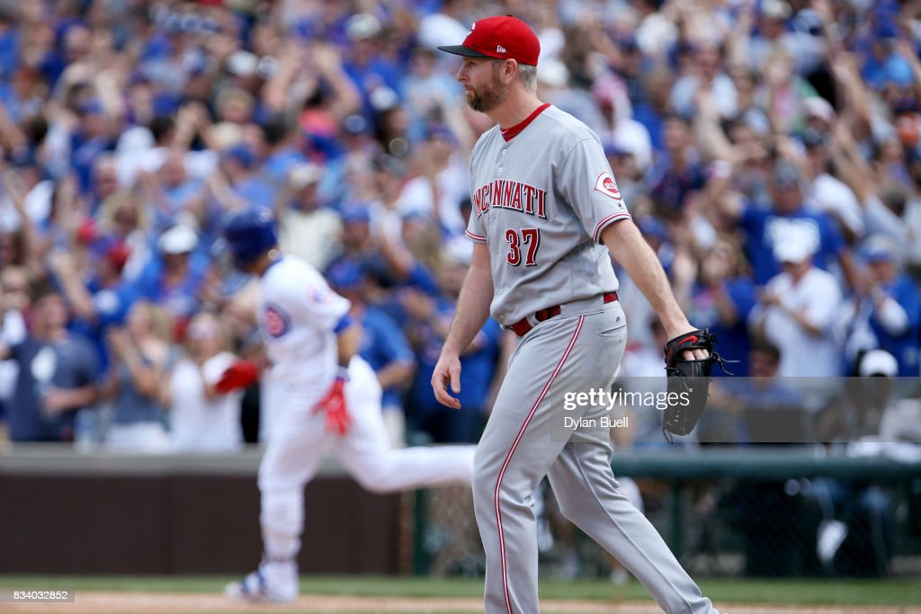 Scott Feldman #37 of the Cincinnati Reds reacts after giving up a home run to Javier Baez #9 of the Chicago Cubs in the fourth inning at Wrigley Field on August 17, 2017 in Chicago, Illinois.