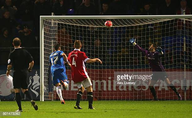 Scott Fenwick of Hartlepool United scores the first goal in extra time during the Emirates FA Cup second round replay match between Hartlepool United...