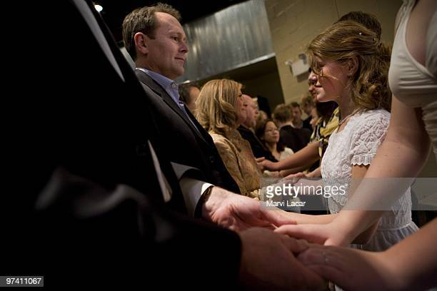 Scott Forhetz places the ring on his daughter's left ring finger during a purity ring ceremony on February 13 2008 at the Full Life Assembly of God...