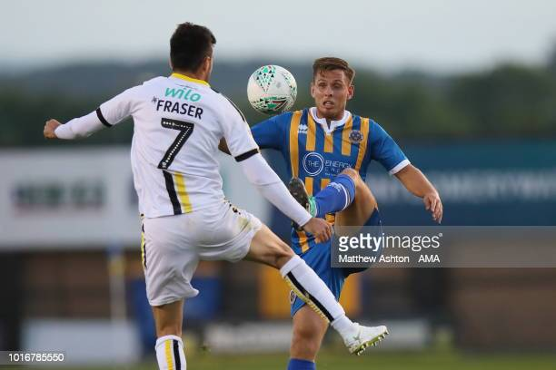 Scott Fraser of Burton Albion and Charlie Colkett of Shrewsbury Town during the Carabao Cup First Round match between Shrewsbury Town and Burton...