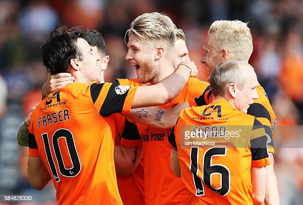 Scott Fraser of Dundee United is congratulated by his team mattes after he scores during the Betfred League Cup group match between Dundee United and...