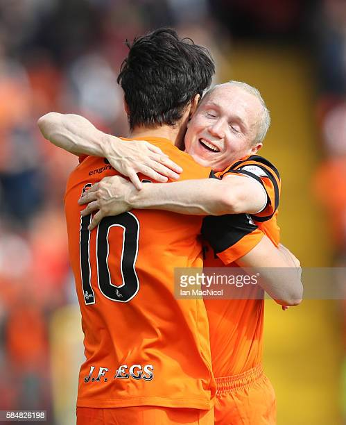 Scott Fraser of Dundee United is congratulated by Willo Flood of Dundee United after he scores during the Betfred League Cup group match between...