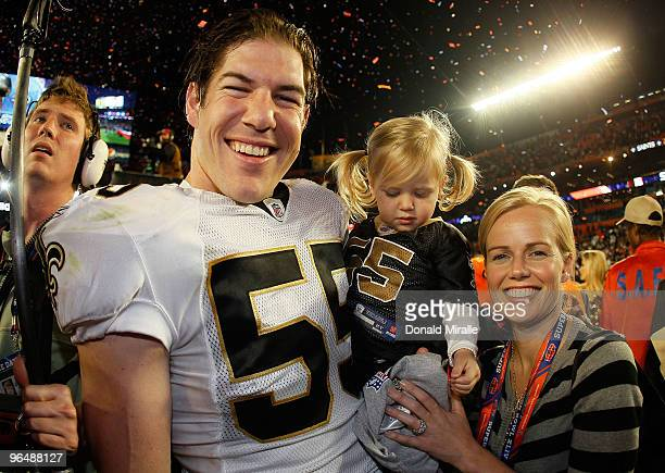 Scott Fujita of the New Orleans Saints and family celebrate after defeating the Indianapolis Colts during Super Bowl XLIV on February 7 2010 at Sun...