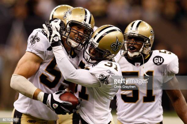 Scott Fujita of the New Orleans Saints celebrates after intercepting the ball at the end of the game against the Tampa Bay Buccaneers at the...