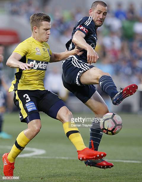 Scott Galloway of Central Coast Mariners and Carl Valeri of Melbourne Victory compete during the round 12 ALeague match between Melbourne Victory and...