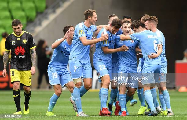 Scott Galloway of Melbourne City is congratulated by team mates after scoring a goal during the round four ALeague match between Melbourne City and...