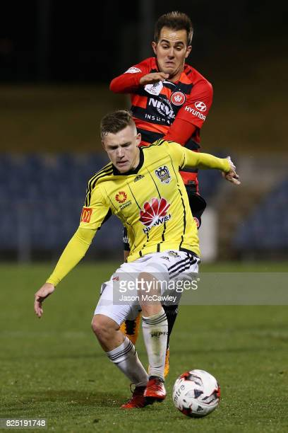 Scott Galloway of the Phoenix and Steven Lustica of the Wanderers compete for the ball during the FFA Cup round of 32 match between the Western...