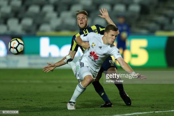 Scott Galloway of the Phoenix contests the ball against Andrew Hoole of the Mariners during the round 21 ALeague match between the Central Coast...
