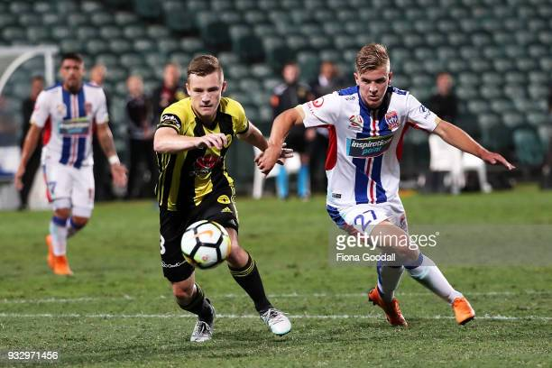Scott Galloway of the Wellington Phoenix is marked by Riley McGree of the Newcastle Jets during the round 23 ALeague match between the Wellington...