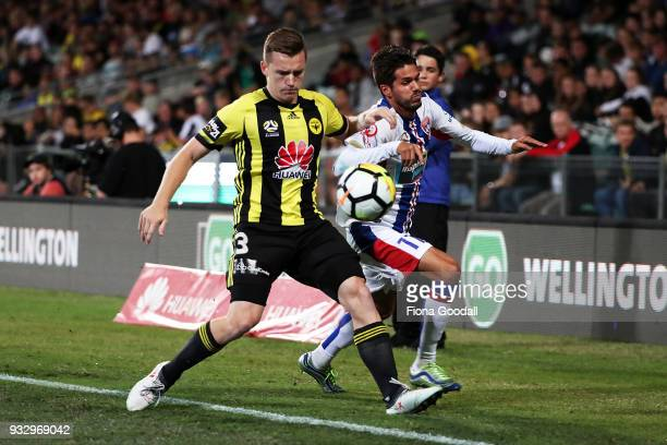 Scott Galloway of the Wellington Phoenix is tackled by Daniel Georgievski of the Newcastle Jets in the round 23 ALeague match between the Wellington...