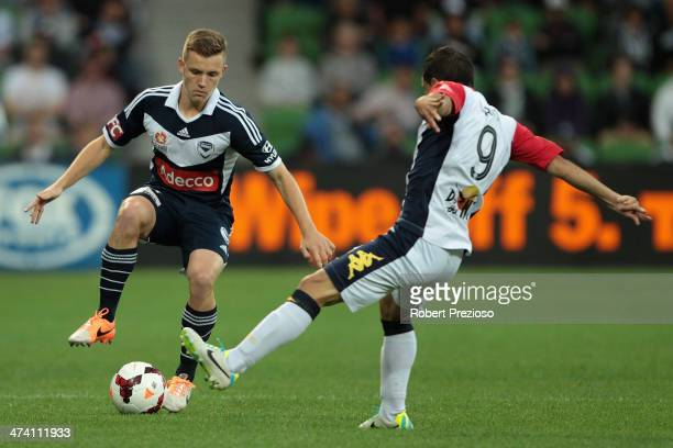 Scott Galloway of Victory and Sergio Cirio of Adelaide contest the ball during the round 20 ALeague match between Melbourne Victory and Adelaide...
