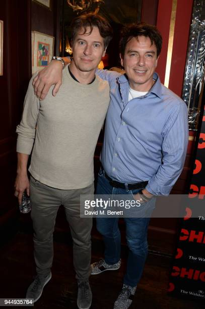Scott Gill and John Barrowman attend the press night after party for 'Chicago' at L'Escargot on April 11 2018 in London England