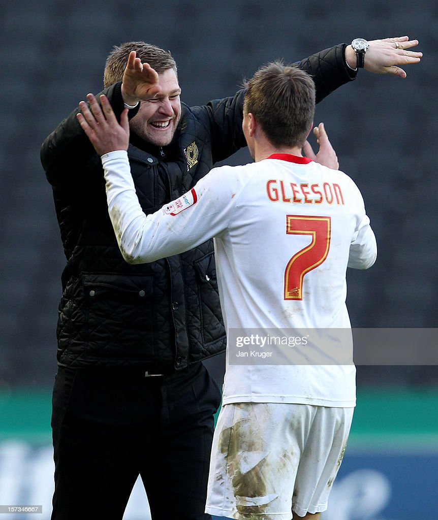Scott Gleeson of MK Dons celebrates with manager Karl Robinson after the FA Cup with Budweiser Second Round match between MK Dons and AFC Wimbledon at StadiumMK on December 2, 2012 in Milton Keynes, England. This match is the first meeting between the two teams following the formation of AFC Wimbledon (the football club formed in 2002 by supporters unhappy with their club's relocation to Milton Keynes) and the MK Dons (which Wimbledon F.C. controversially became).