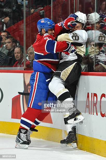 Scott Gomez of Montreal Canadiens collides with Kris Letang of the Pittsburgh Penguins in Game Six of the Eastern Conference Semifinals during the...