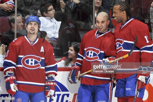 Scott Gomez of the Montreal Canadiens and teammates Georges Laraque and Brian Gionta warm up before during the NHL game against the Florida Panthers...