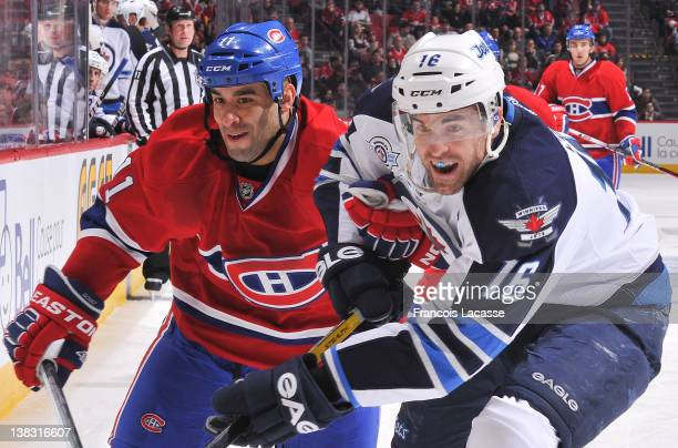 Scott Gomez of the Montreal Canadiens battles for the puck with Andrew Ladd of the Winnipeg Jets during the NHL game on February 5 2012 at the Bell...