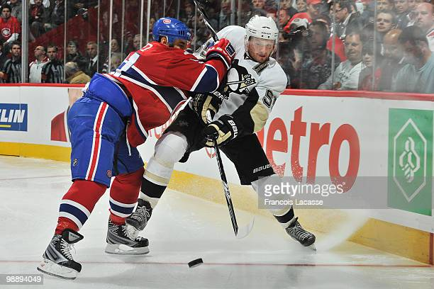 Scott Gomez of the Montreal Canadiens collides with Sergei Gonchar of the Pittsburgh Penguins in Game Four of the Eastern Conference Semifinals...