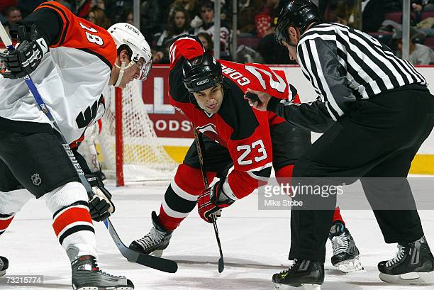 Scott Gomez of the New Jersey Devils faces off against Mike Richards of the Philadelphia Flyers at Continental Airlines Arena on January 20 2007 in...