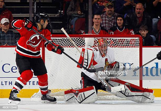 Scott Gomez of the New Jersey Devils misses a deflection attempt as Craig Anderson of the Ottawa Senators makes the stick save during the third...