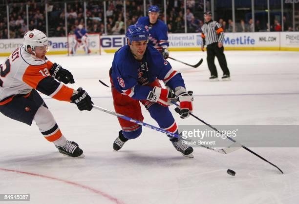 Scott Gomez of the New York Rangers skates around Josh Bailey of the New York Islanders on February 18 2009 at Madison Square Garden in New York City